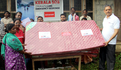 Sh. C. Balaji Singh, Executive Director, Care Today Fund, hands over a mattress to a flood affected survivor in Pettimudi, Idukki district